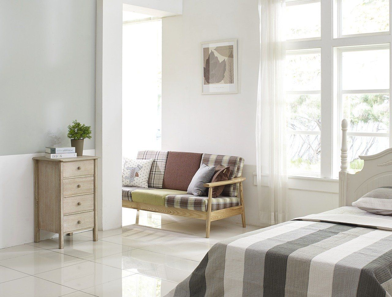 Foto Un dormitorio relajante usando el color gris como aliado